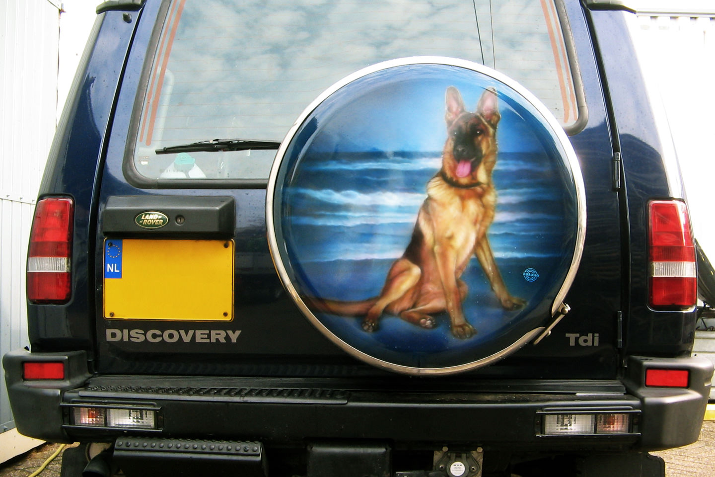 Wheelcover Landrover Discovery schildering herdershond